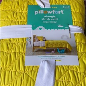 Twin yellow pillow fort triangle stitch quilt